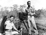 Photographers Jack Heyn (sitting) and Marvin Culbreth (standing) of USAAF 3rd Bomb Group, Dobodura Airfield, Australian Papua, mid-1943