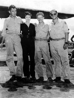 USAAF 3rd Bomb Group photographer Jack Heyn, actress Una Merkel, and two 2nd Bomb Command cinematographers at Dobodura Airfield, Australian Papua, mid-1943