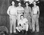 Roland Holmberg (rear far left), Robert Boucher (rear center left), Jack Heyn (rear center right), John Barr (rear far right), and Brackett (front) of USAAF 3rd Bomb Group photographic section, Dobodura Airfield, Australian Papua, mid-1943