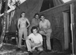 Seeley (rear left), John Paulovitch (rear center), Shemlynce (rear right), and Berube (front) of USAAF 3rd Bomb Group photographic section, Dobodura Airfield, Australian Papua, mid-1943