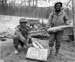 African American US Army soldiers T/5 William E. Thomas and Private First Class Joseph Jackson marking artillery shells as Easter presents for Adolf Hitler, 10 Mar 1945