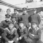 Japanese Navy officers and men aboard a ship, date unknown