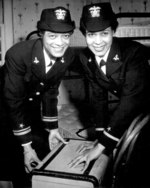 African-American US Navy WAVE Lt. (jg) Harriet Ida Pickens and Ens. Frances Wills posing at their quarters at Naval Reserve Midshipmen