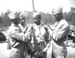 African-American US Army 2nd lts. Henry Harris, Frank Frederick Doughton, Elmer B. Kountze, and Rogers H. Beardon pinning on their new brass rank insignias, Ft. Benning, Georgia, US, 29 May 1942