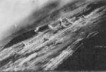 View of Toshien (now Zuoying) harbor and airfield, Takao (now Kaohsiung), Taiwan, 12 Oct 1944, photo 1 of 3; photo taken from aircraft of USS Wasp