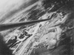 View of Toshien (now Zuoying) harbor and airfield, Takao (now Kaohsiung), Taiwan, 12 Oct 1944, photo 2 of 3; photo taken from aircraft of USS Wasp