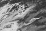 View of Toshien (now Zuoying) harbor and airfield, Takao (now Kaohsiung), Taiwan, 12 Oct 1944, photo 3 of 3; photo taken from aircraft of USS Wasp