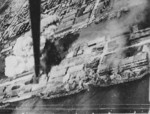 Takao (now Kaohsiung) harbor, Taiwan under US Navy carrier aircraft attack, 12 Oct 1944, photo 1 of 6