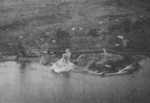 Rising Sun Petroleum Company facilities and nearby military seaplane base at Tamsui, Taiwan under attack by aircraft from USS Intrepid, 12 Oct 1944, photo 1 of 3