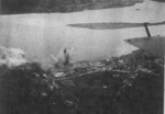 Rising Sun Petroleum Company facilities and nearby military seaplane base at Tamsui, Taiwan under attack by aircraft from USS Intrepid, 12 Oct 1944, photo 2 of 3