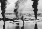 Seaplane hangars under US Navy carrier aircraft attack, Toko Bay (now Dapeng Bay), southern Taiwan, 12 Oct 1944, photo 3 of 7