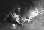 Seaplane hangars under US Navy carrier aircraft attack, Toko Bay (now Dapeng Bay), southern Taiwan, 12 Oct 1944, photo 4 of 7