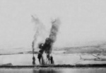 Seaplane hangars under US Navy carrier aircraft attack, Toko Bay (now Dapeng Bay), southern Taiwan, 12 Oct 1944, photo 6 of 7