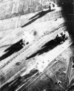 Carrier aircraft of Task Force 38 attacking the Japanese Army airfield at Takao (now Kaohsiung), Taiwan, 12 Oct 1944, photo 1 of 4; US intelligence referred to this field as