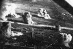 Carrier aircraft of Task Force 38 attacking the Japanese Army airfield at Takao (now Kaohsiung), Taiwan, 12 Oct 1944, photo 2 of 4; US intelligence referred to this field as