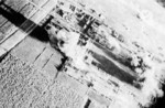 Carrier aircraft of Task Force 38 attacking the Japanese Army airfield at Takao (now Kaohsiung), Taiwan, 12 Oct 1944, photo 4 of 4; US intelligence referred to this field as