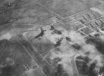 Shinchiku Airfield under US Navy carrier aircraft attack, Taiwan, 12 Oct 1944, photo 1 of 2