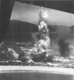 Suo (now Suao) harbor under attack by a PB4Y-1 aircraft of US Navy squadron VPB-104, eastern Taiwan, 22 Apr 1945, photo 1 of 4