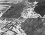 Suo (now Suao) harbor under attack by a PB4Y-1 aircraft of US Navy squadron VPB-104, eastern Taiwan, 22 Apr 1945, photo 3 of 4