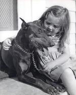 Carole Brick, daughter of USMC Captain Samuel Brick, with a war dog trainee, Camp Lejeune, New River, North Carolina, United States, 1943