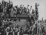 Men of US Marines 10th Amphibious Tractor Battalion celebrating victory over Japan, Aug 1945