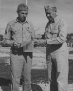 US Marine 3rd Amphibious Corps photographer William H. T. Swisher receiving Bronze Star medal from General Rockey, Guam, circa 1944