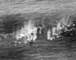 Small Taiwanese vessel being stafed by PB4Y-2 aircraft of US Navy VPB-104, just off Dongji Island, Pescadores Islands, 7 Aug 1945