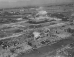 Kagi butanol plant under attack by B-25 bombers of 3rd Bombardment Group, USAAF 5th Air Force, Kagi (now Chiayi), Taiwan, 3 Apr 1945, photo 2 of 5