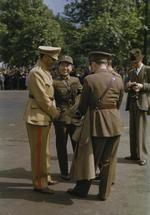 An Iranian, a Chinese, and two British officers in conversation during the United Nations Day Parade, London, England, United Kingdom, 14 Jun 1943