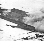 The prison at Amiens, France under RAF, RNZAF, RAAF attack with Mosquito bombers during Operation Jericho, 18 Feb 1944