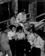 African-American US Army nurses receiving mail from home, 268th Station Hospital, Australia, 29 Nov 1943; 3 of the nurses were Lts. Prudence L. Burns, Inez Holmes, and Birdie E. Brown