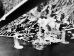 Taikoo Dockyard facilities under American aerial attack, Hong Kong, 16 Jan 1945. Photo 1 of 2