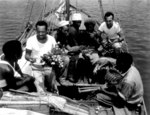 African-American MS2c Percy Hope, S1c Lilton Walker, and SC1c Jack Kelsen of USN 34th Construction Battalion trading with natives of Malaita at Halavo, Florida Island, Solomon Islands, 23 Sep 1943