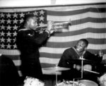 African-American US Navy Construction Battalion Coxswain Thomas J. Lindsey (trumpeter) and Seaman 1st Class Edward A. Grant (drummer) playing in England, United Kingdom, 14 Dec 1944