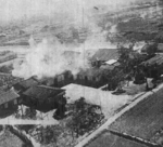 Civilian homes being bombed by B-25 bombers of USAAF 405th Bombardment Squadron B-25, Kagi, Taiwan, 3 Apr 1945