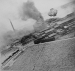 Nansei sugar plant under US air attack, Kagi (now Chiayi), Taiwan, 24 Apr 1945, photo 1 of 3