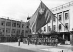 Raising the Chinese flag at the Chinese occupation headquarters in Osaka, Japan, 8 Sep 1945