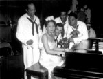 African-American pianist Dorothy Donegan playing with the Camp Robert Smalls swing band at US Navy Naval Training Station, Great Lakes, Illinois, United States, 16 Jun 1943
