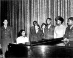 Contralto singer Marian Anderson entertaining a group of African-American US Army personnel, San Antonio Municipal Auditorium, San Antonio, Texas, United States, 11 Apr 1945