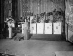 Stage singer Josephine Baker singing the American national anthem before an African-American US Army band directed by Technical Sergeant Frank W. Weiss, Municipal Theater, Oran, Algeria, 17 May 1943