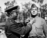 African-American US Army Captain E. H. Lowe pinning the 2nd Lieutenant insignia on James B. Morris, Camp Columbia, Brisbane, Australia, 29 Jun 1943