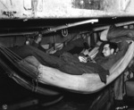 US Army soldier relaxing with a book while aboard a transport, off Iceland, 20 May 1943