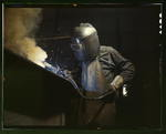 American welder making boilers for a ship, Combustion Engineering Company, Chattanooga, Tennessee, United States, Jun 1942, photo 1 of 2