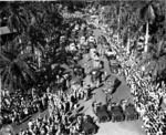 Returning Japanese-American veterans of US 442nd Regimental Combat Team parading through the the Iolani Palace grounds, Honolulu, US Territory of Hawaii, 9 Aug 1946