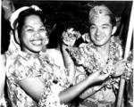 Japanese-American soldier of US 442nd Regimental Combat Team receiving a lei from a member of a welcoming committee, Honolulu, US Territory of Hawaii, 9 Aug 1946
