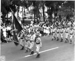 Japanese-American troops of US 442nd Regimental Combat Team marching in the Veterans Day Parade at Kapiolani Park, Honolulu, US Territory of Hawaii, 15 Aug 1946, photo 1 of 2