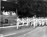 Japanese-American troops of 100th Infantry Battalion, US 442nd Regimental Combat Team marching during the Veterans Day Parade at Kapiolani Park, Honolulu, US Territory of Hawaii, 15 Aug 1946