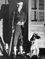 US Coast Guard sentry and dog at their post during WW2