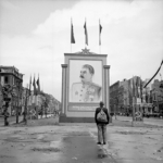 A German civilian looks at a vast painting of Stalin on the Unter-den-Linden, Berlin, Germany, 3 Jun 1945
