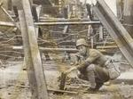 Chinese soldier setting up obstacles in an urban street, date unknown